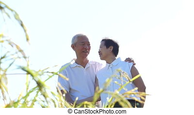 Asian senior couple meadow field - Cool Asian senior couple...