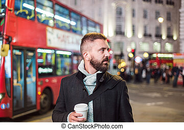 Man with coffee cup - Young handsome man with coffee cup in...