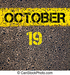 19 October calendar day over road marking yellow paint line