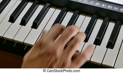 playing man piano synthesizer hand run over keys - playing...