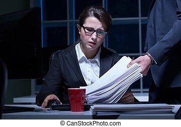 Woman working overtime - Sleepy woman working overtime in...