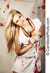 Inhospitable Horror Hospital - A smiling sexy nurse in a...