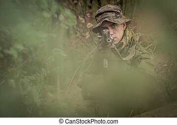 Camouflaged commando assault - Photo of camouflaged commando...