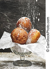 Delicious freshly baked donuts sprinkled with powdered sugar...