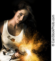 Woman With Angle Grinder Spraying Sparks - Dark portrait of...