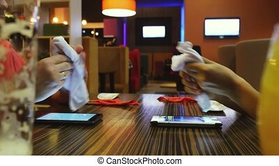 Couple Wipe your hands with a towel before trapeza. A very common attitude in any japanese restaurant