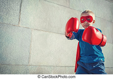Power - Little boy with boxing gloves outdoors