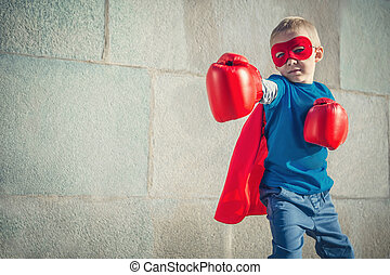 Battle - Boy with boxing gloves outdoors