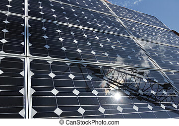 Solar Panel with Reflection of Wind Turbine