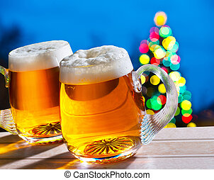 Beers and Christmas tree - two beer glasses with colored...
