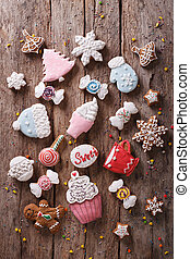 Christmas gingerbread in pastel colors vertical top view -...