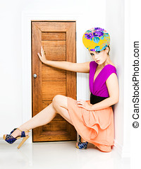 Fashion Police Blocking Doorway - Young trendy woman in...