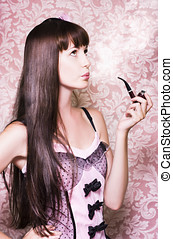 Pipe Dream - Pretty young woman smoking a pipe and looking...