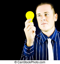Young man holding light bulb in hand