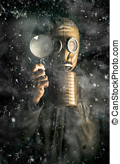 Climate Change - Scientist wearing a gas mask and holding a...