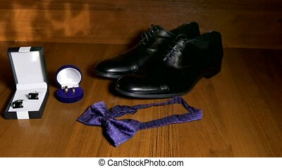 shoes bowtie tie and cufflinks on the table Wedding...