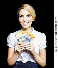 Business woman holding a cash bonanza - Attractive blonde...