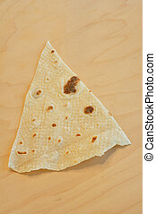 Norwegian Lefse (flatbread) on a wooden cutting board