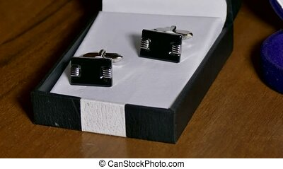 Man Cufflinks are in the box on the table - Man Cufflinks...