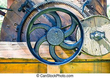 cast iron valve - Cast iron valve - part of old wooden...