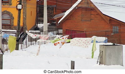 Drying clothes hanging on a clothesline in the winter on the...
