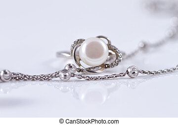 Unusual beautiful silver chain and a silver ring with pearl