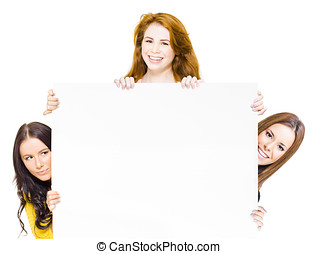Three happy women with promotional sign - Three happy women...