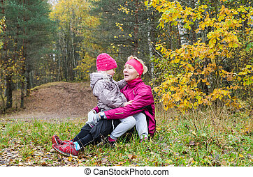 Grandmother with her granddaughter in the park - Grandmother...
