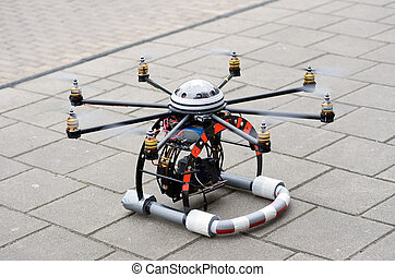 Octocopter take-off - An octocopter on the ground ready for...