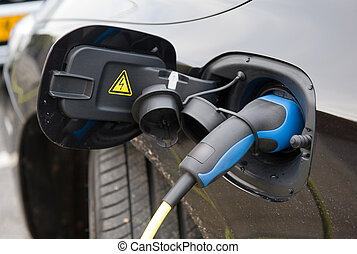 Electric car at charging station - An electic car charging...