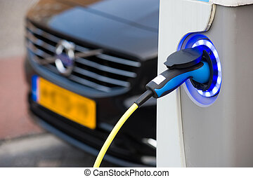 Electric car at charging station - ENSCHEDE, The NETHERLANDS...