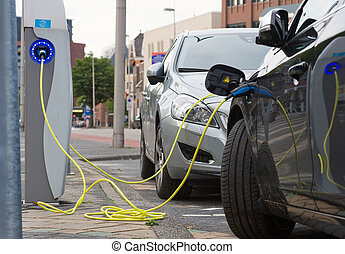 Electric cars at charging station - ENSCHEDE, The...