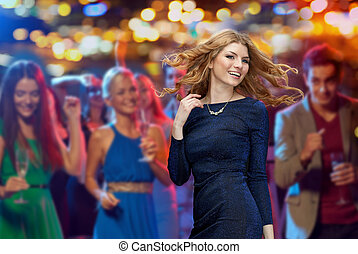 happy young woman dancing at night club disco - party,...