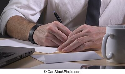 Businessman writing resignation notice letter, leaving job,...