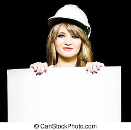 Female architect holding blank blueprint design - Isolated...