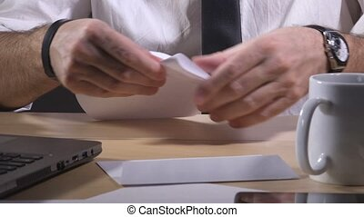 Businessman sending letter - Businessman putting folded...