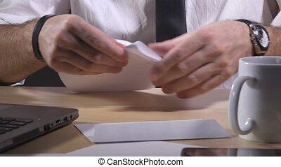Businessman sending letter