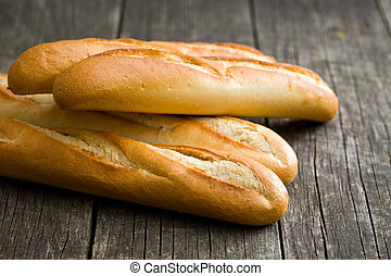 french baguettes on old wooden background