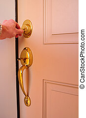 Locking a Dead Bolt - Hand Locking a Dead Bolt Deadbolt with...