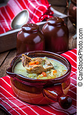 Cucumber soup. - Cucmber soup with ingredients on a wooden...