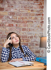 Female student thinking about her homework - Portrait of a...