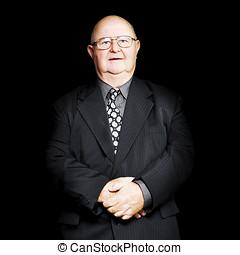 Senior business man isolated on black background - Isolated...
