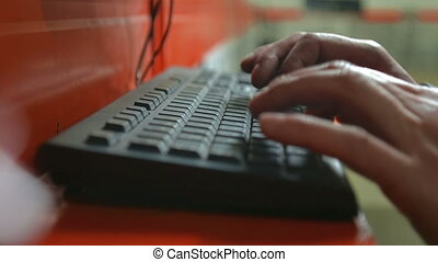 Man typing on keyboard.