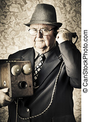 Vintage business man using retro telephone - Image of a old...