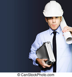 Driven and determined engineer in builder hardhat - Driven...