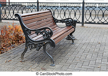 benches on a city street in autumn