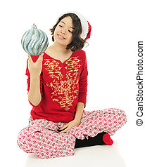My Favorite Christmas Bulb - A pretty Hispanic girl in her...