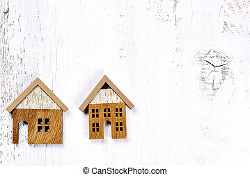 two wooden little houses - conceptual background - two brown...
