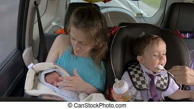 Woman with two children traveling in car - Family traveling...