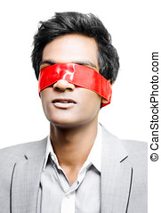 Blinded by red tape or Held to ransom - A young Asian...